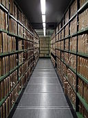 A_corridor_of_files_at_The_National_Archives